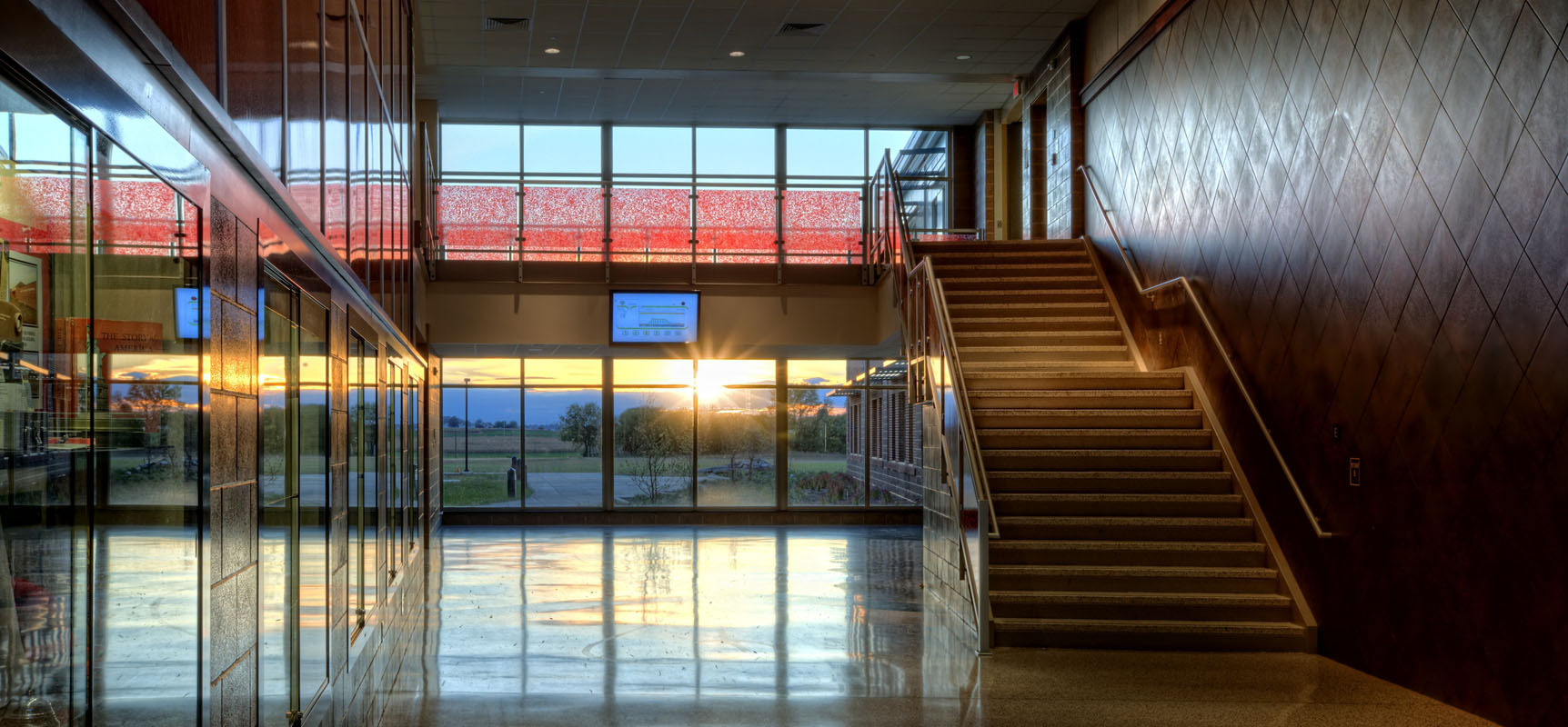 corridor intersection allowing daylight to stream into the building at Warwick School District Middle School